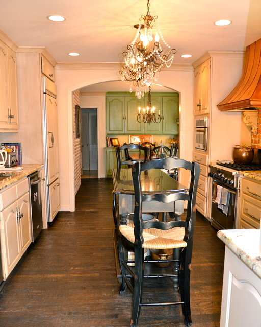 Large elegant u-shaped dark wood floor and brown floor eat-in kitchen photo in Austin with raised-panel cabinets, stone tile backsplash, stainless steel appliances, an island, a farmhouse sink, beige cabinets, granite countertops and white backsplash