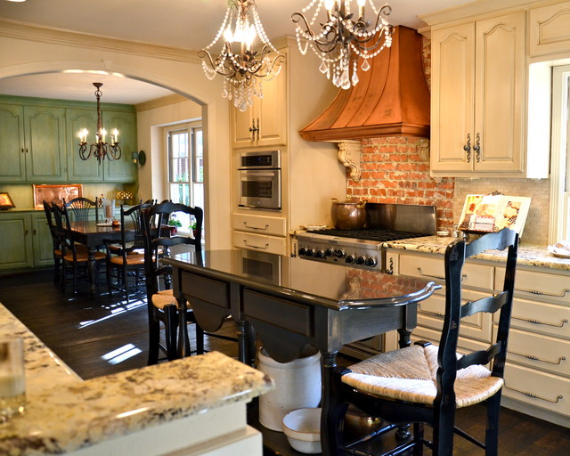 Eat-in kitchen - large traditional u-shaped dark wood floor and brown floor eat-in kitchen idea in Austin with granite countertops, stainless steel appliances, a farmhouse sink, shaker cabinets, beige cabinets, white backsplash, glass tile backsplash and an island