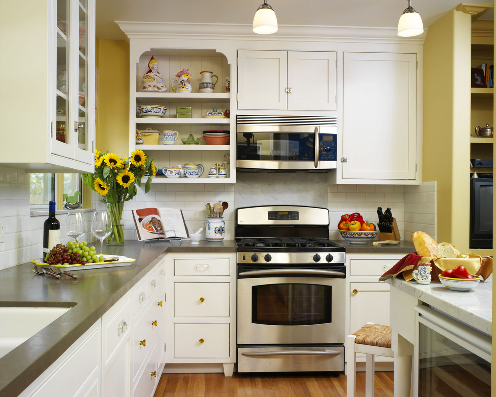 Inspiration for a timeless kitchen remodel in Los Angeles with subway tile backsplash, concrete countertops, beaded inset cabinets, white cabinets, white backsplash and stainless steel appliances