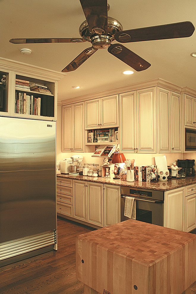 Inspiration for a huge timeless u-shaped medium tone wood floor and brown floor eat-in kitchen remodel in DC Metro with an island, an undermount sink, raised-panel cabinets, beige cabinets, granite countertops and stainless steel appliances