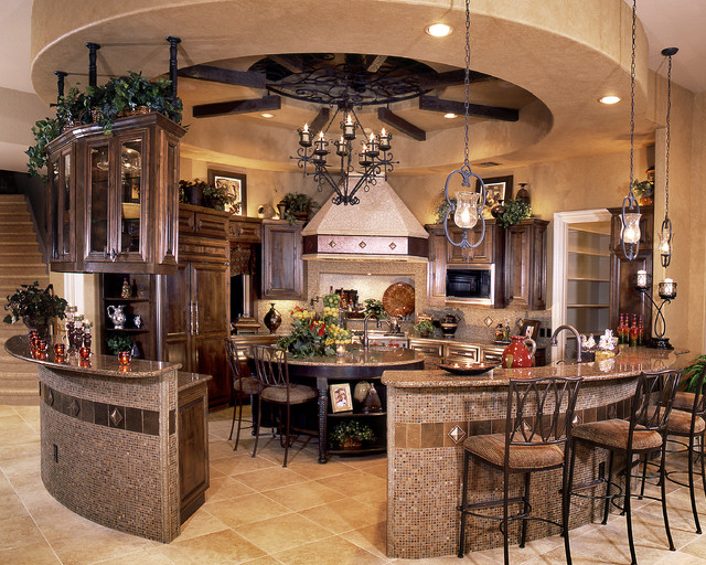 example of a tuscan u shaped ceramic floor enclosed kitchen design in austin with a - Mediterranean Kitchen