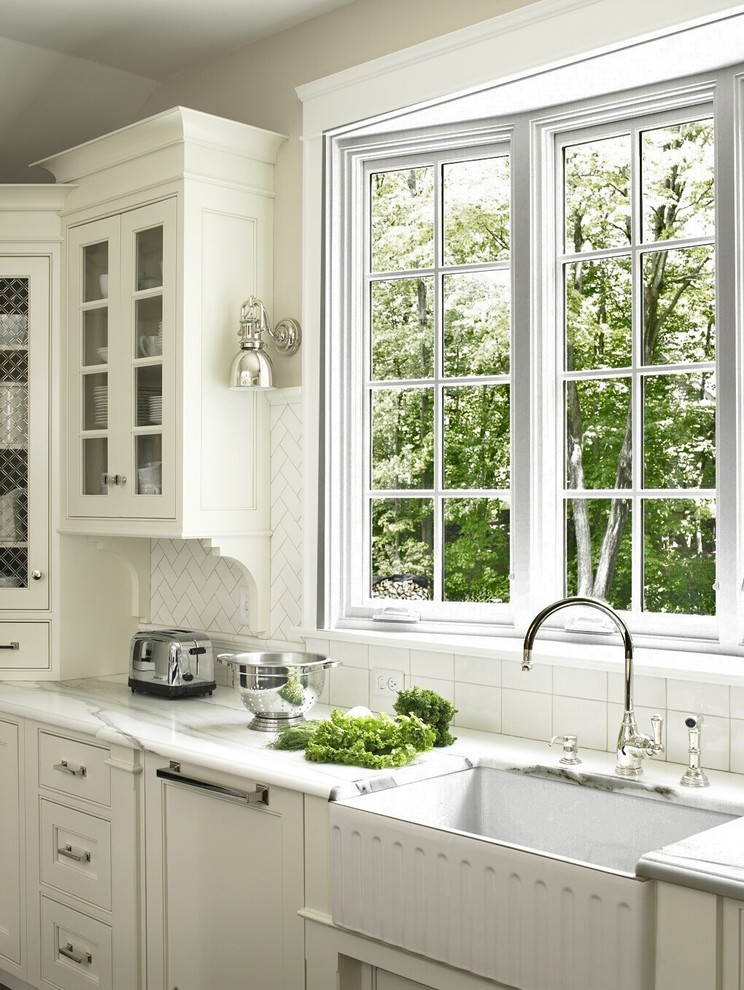 Inspiration for a timeless kitchen remodel in DC Metro with a farmhouse sink, recessed-panel cabinets, white cabinets, white backsplash and subway tile backsplash