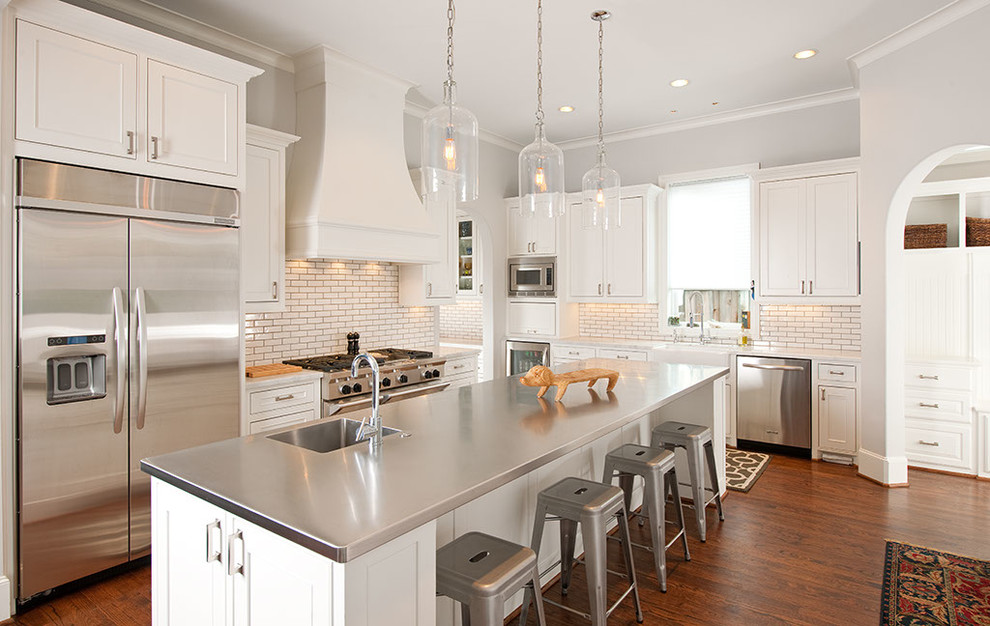 Example of a trendy kitchen design in Dallas with stainless steel countertops and an integrated sink
