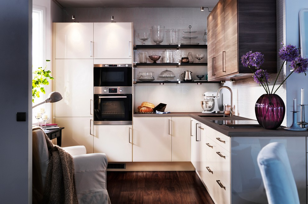 Kitchen - contemporary kitchen idea in Other with flat-panel cabinets and beige cabinets