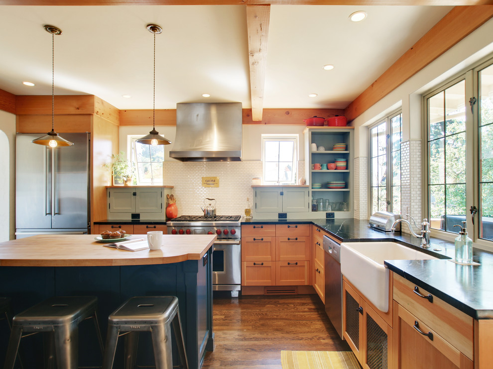 Inspiration for a timeless kitchen remodel in Seattle with a farmhouse sink, soapstone countertops, stainless steel appliances and white backsplash