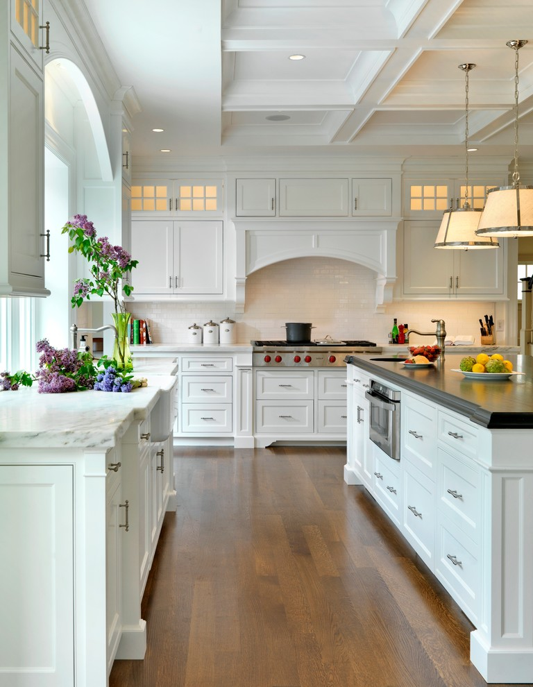Kitchen - traditional kitchen idea in Boston with a farmhouse sink, marble countertops, white cabinets, beaded inset cabinets, white backsplash and subway tile backsplash