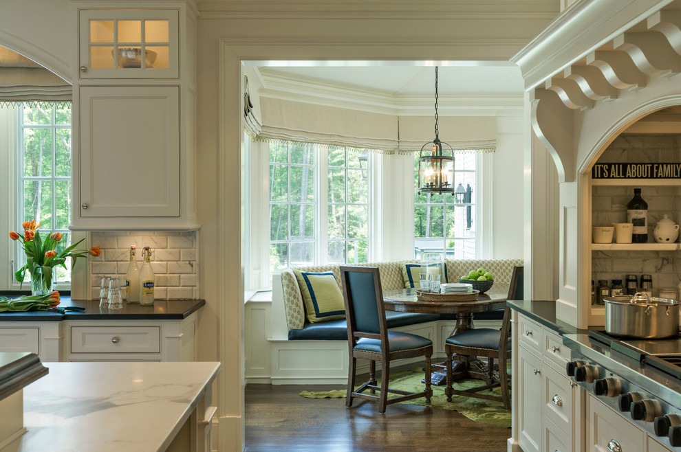 Kitchen - transitional kitchen idea in Boston with recessed-panel cabinets, white cabinets, white backsplash and stainless steel appliances