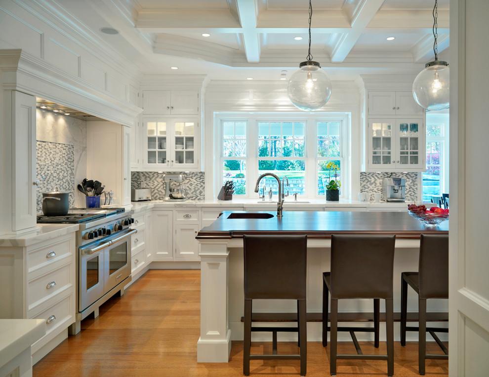 Elegant kitchen photo in Boston with mosaic tile backsplash and marble countertops