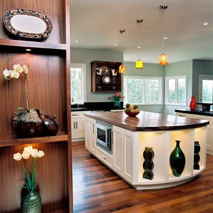 Eat-in kitchen - large contemporary u-shaped light wood floor eat-in kitchen idea in San Francisco with an integrated sink, recessed-panel cabinets, white cabinets, wood countertops, green backsplash, glass tile backsplash, stainless steel appliances and an island