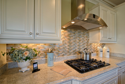 There is a 4 inch granite lift backsplash then the tile for 3 4 inch granite countertops