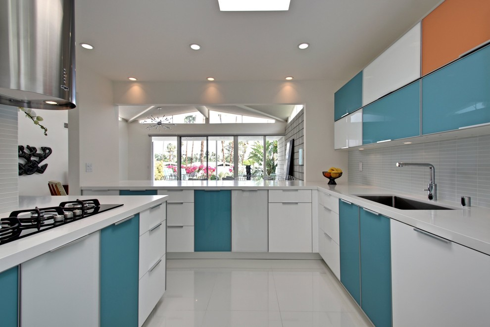 Eat-in kitchen - small modern l-shaped eat-in kitchen idea in Los Angeles with flat-panel cabinets, white cabinets, white backsplash and a peninsula