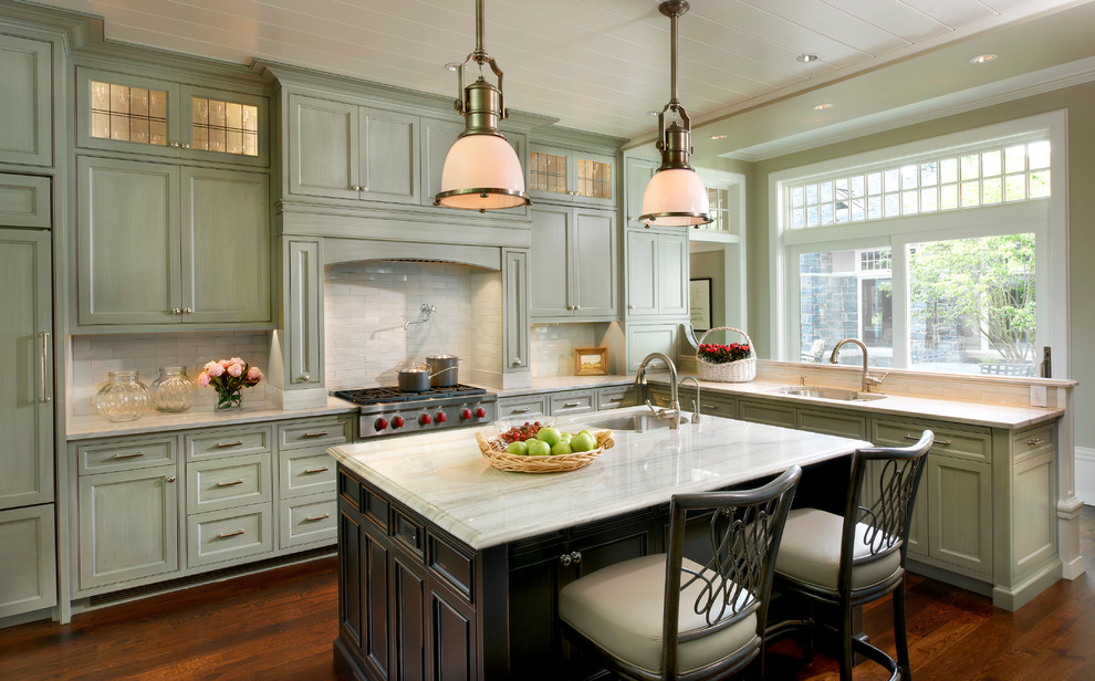 Example of a classic dark wood floor kitchen design in Chicago with an undermount sink, recessed-panel cabinets, green cabinets, white backsplash and paneled appliances