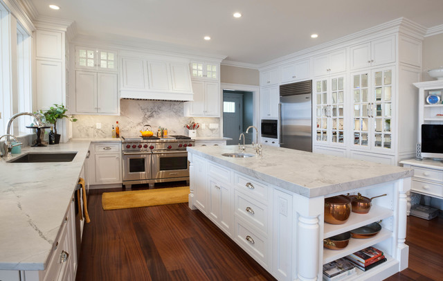 Example Of A Classic U Shaped Dark Wood Floor Kitchen Design In Portland  Maine With
