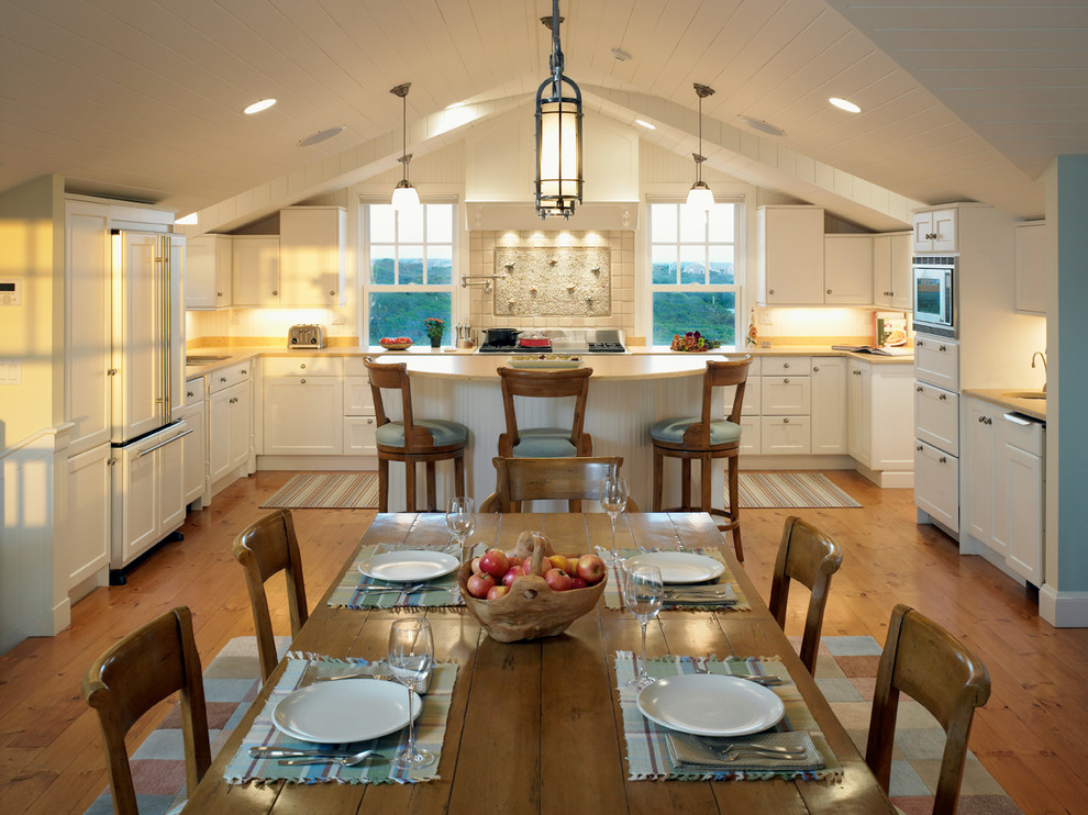 Eat-in kitchen - traditional u-shaped eat-in kitchen idea in Boston with recessed-panel cabinets and white cabinets
