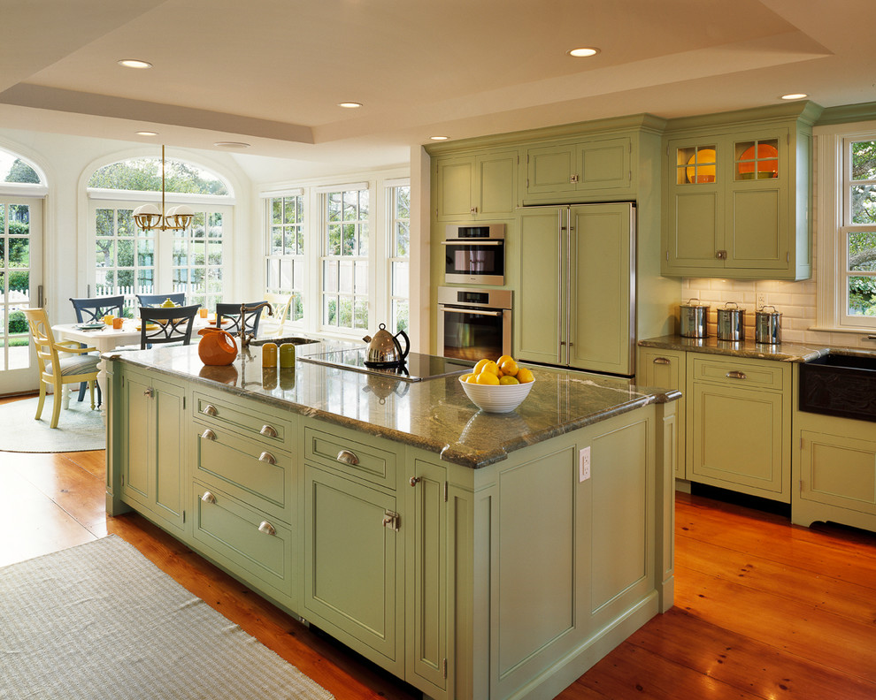 Example of a classic kitchen design in Boston with subway tile backsplash