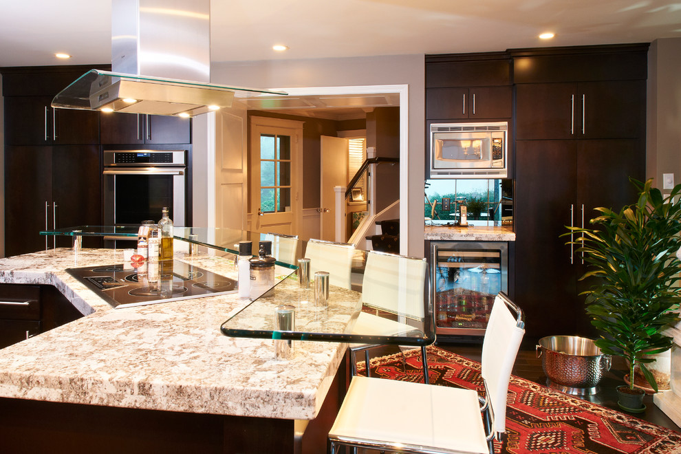 Example of a minimalist kitchen design in Philadelphia with glass countertops
