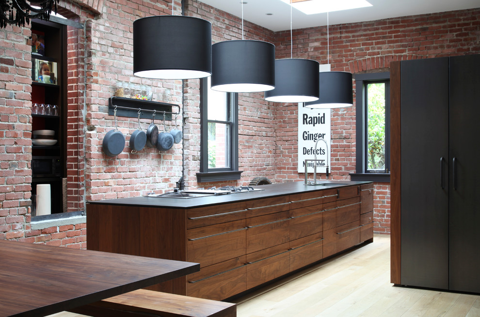 Kitchen - contemporary galley kitchen idea in San Francisco with an undermount sink, flat-panel cabinets and medium tone wood cabinets