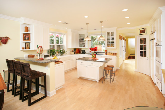 U Shaped Kitchen Photo In Orange County With A Farmhouse Sink Recessed Panel