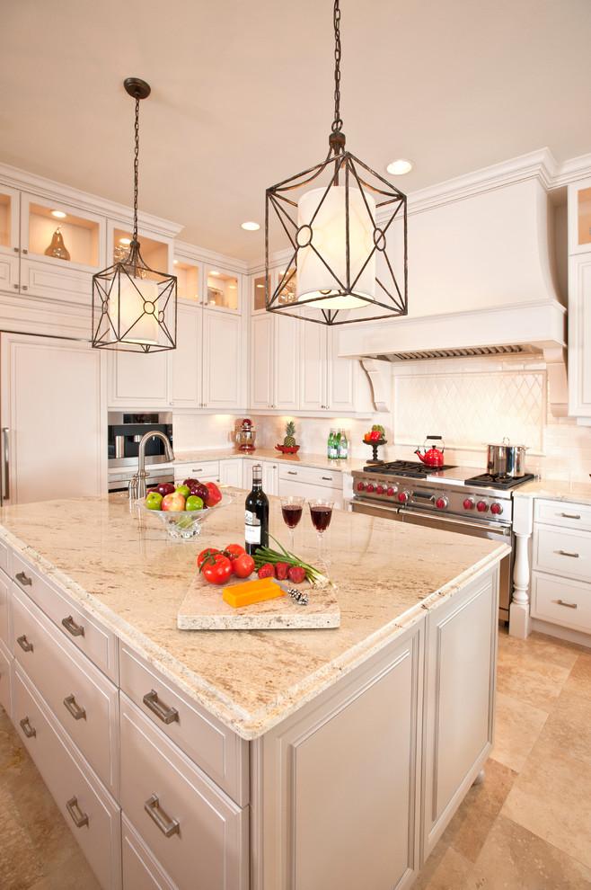 Elegant kitchen photo in Tampa with paneled appliances