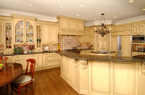 Love the half arch cabinet doors. Who makes them?