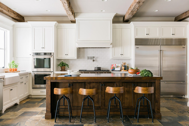 Example of a farmhouse kitchen design in Atlanta with a farmhouse sink, recessed-panel cabinets and an island