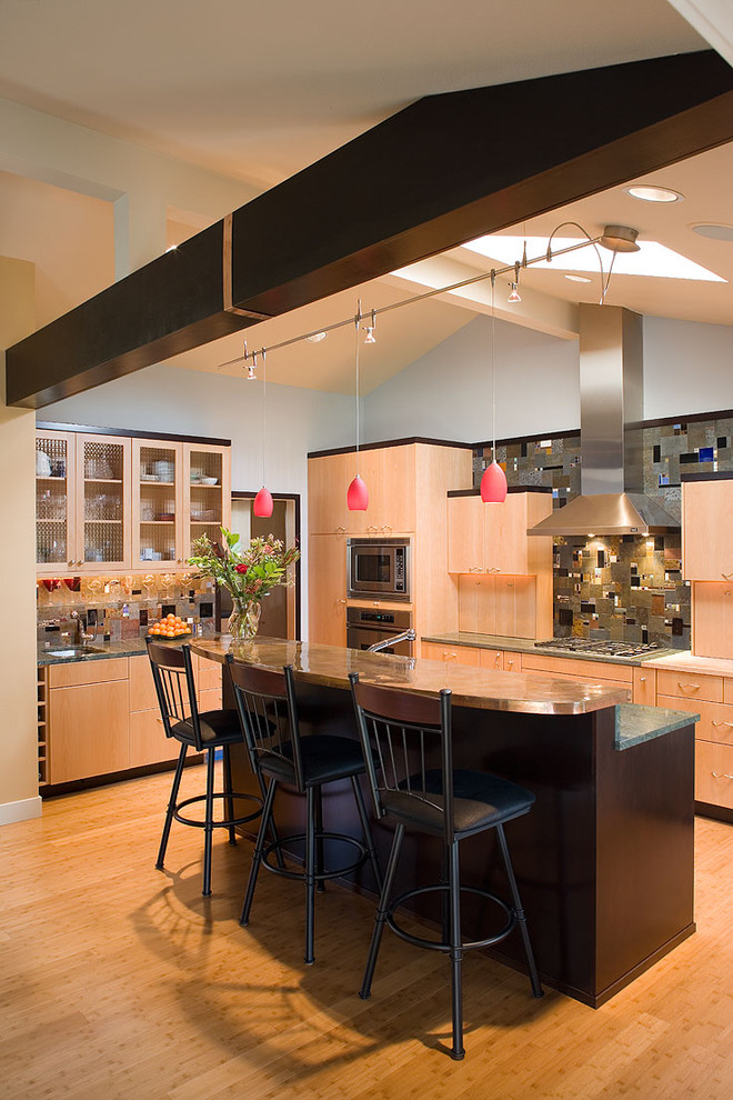 Example of a trendy galley kitchen design in Portland with flat-panel cabinets, medium tone wood cabinets, copper countertops, multicolored backsplash and mosaic tile backsplash