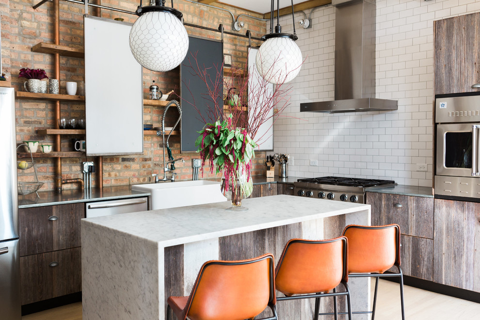 Kitchen - industrial l-shaped light wood floor and beige floor kitchen idea in Chicago with a farmhouse sink, open cabinets, white backsplash, subway tile backsplash, stainless steel appliances and an island