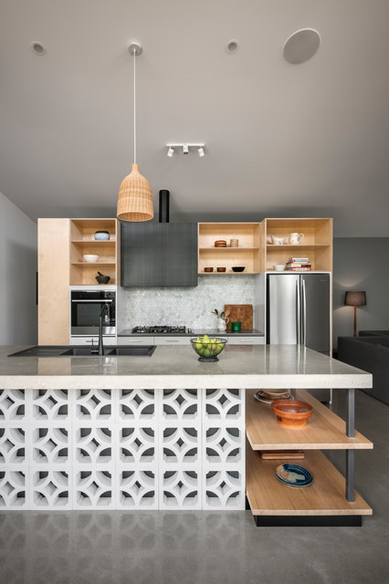Photo of a contemporary galley open plan kitchen in Adelaide with a double-bowl sink, open cabinets, light wood cabinets, grey splashback, mosaic tiled splashback, stainless steel appliances, concrete flooring, an island and grey floors.