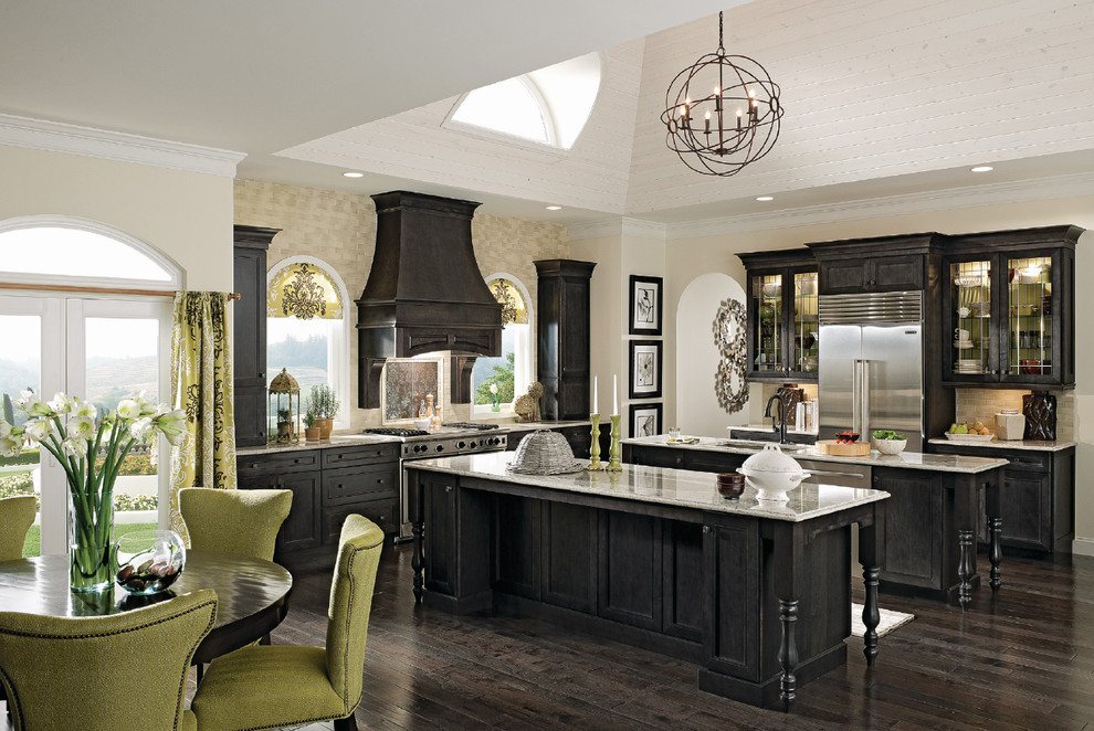 Example of a large transitional l-shaped dark wood floor and brown floor eat-in kitchen design in Richmond with an undermount sink, shaker cabinets, black cabinets, granite countertops, beige backsplash, stainless steel appliances and two islands