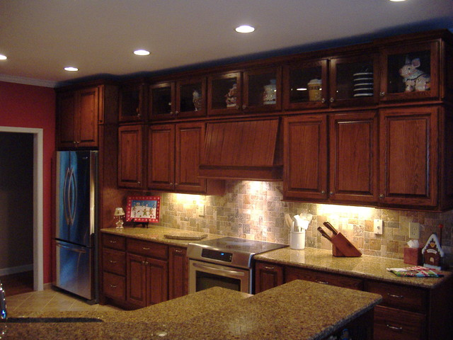 Kraftmaid courtland oak square in chocolate with mocha glaze by kraftmaid traditional Kitchen design center atlanta
