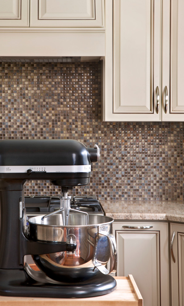 Transitional u-shaped eat-in kitchen photo in Detroit with an undermount sink, multicolored backsplash, mosaic tile backsplash and stainless steel appliances