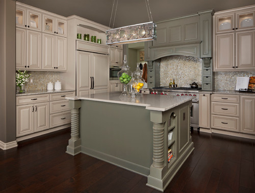 An off-white and olive green traditional styled kitchen remodel with raised panel cabinet doors.