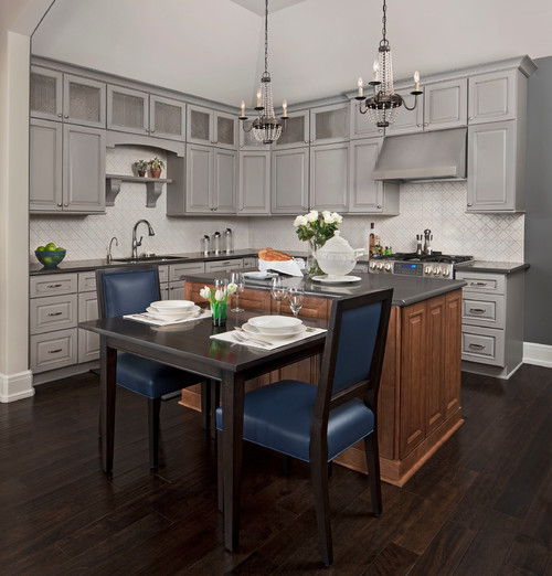 Kitchen by KSI, Michigan featuring gray cabinets from Dura Supreme Cabinetry and navy blue kitchen accessories and decor.