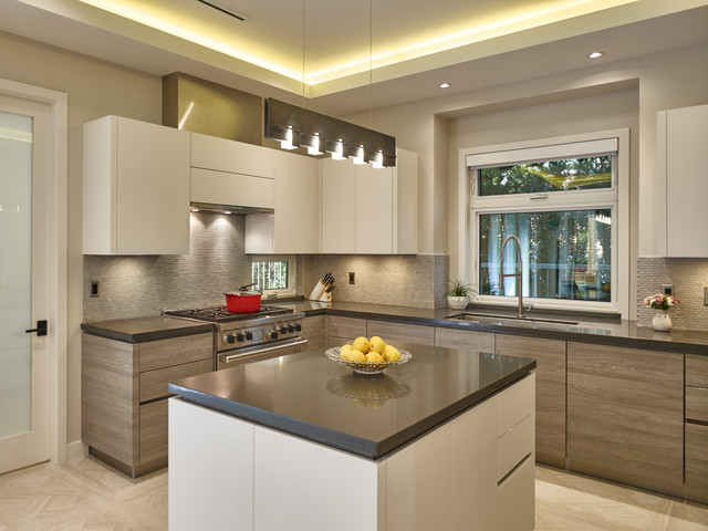 Mid-sized trendy u-shaped porcelain floor eat-in kitchen photo in Vancouver with an undermount sink, flat-panel cabinets, light wood cabinets, granite countertops, gray backsplash, stone tile backsplash, stainless steel appliances and an island