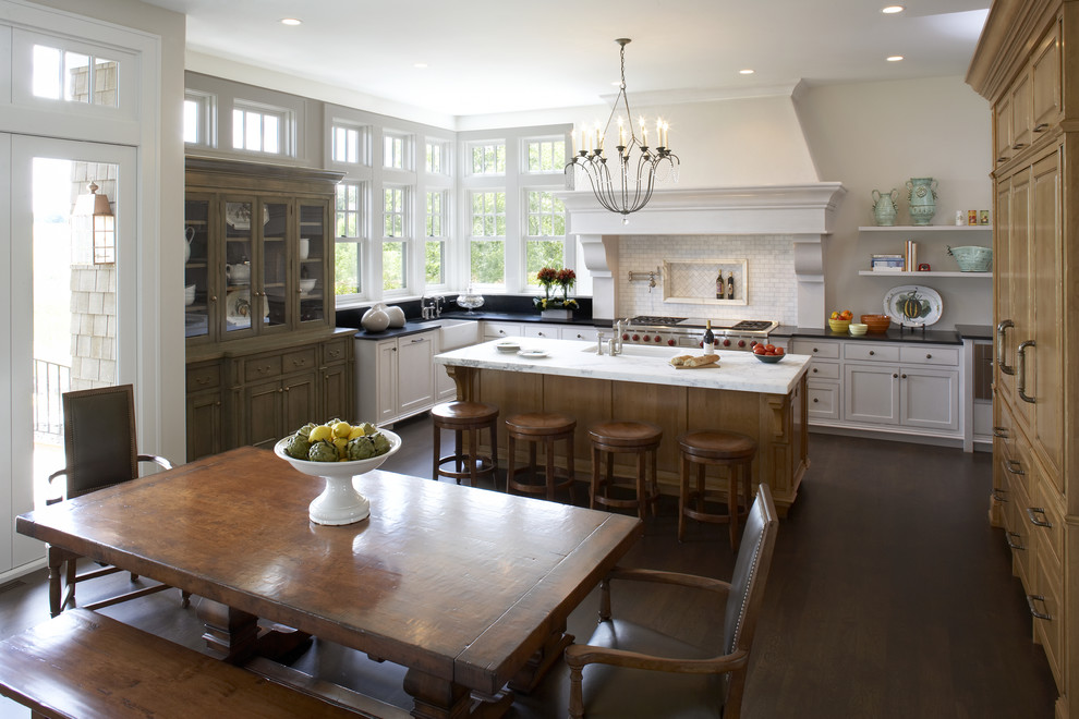 Eat-in kitchen - traditional eat-in kitchen idea in Minneapolis with raised-panel cabinets, medium tone wood cabinets, white backsplash and stainless steel appliances