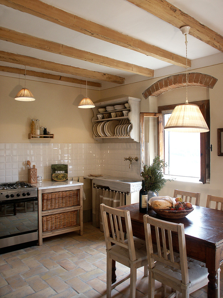 Eat-in kitchen - cottage eat-in kitchen idea in Atlanta with open cabinets and white backsplash