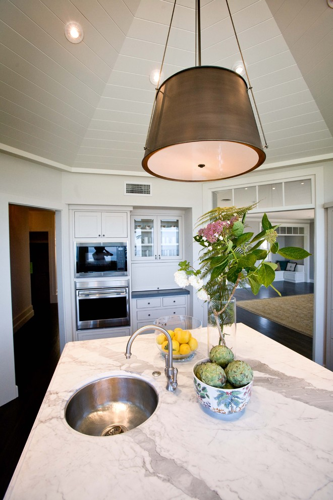 Kitchen - traditional kitchen idea in San Diego with marble countertops