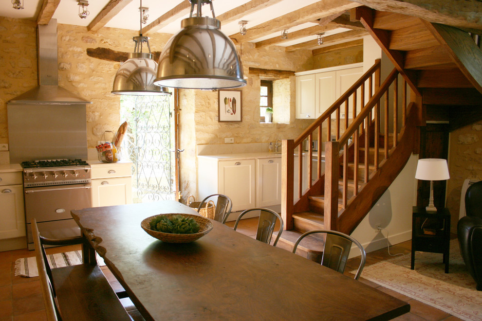 French country kitchen photo in Seattle with stainless steel appliances