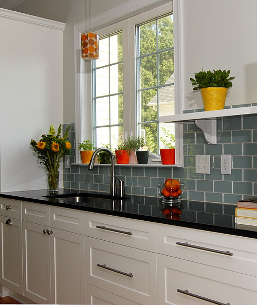 The Backsplash Is A Classic 3 X 6u2033 Honed Calcutta Marble Subway Tile Which  Will Never Go Out Of Style. It Is The Focal Point Of This Simple Black And  White ...