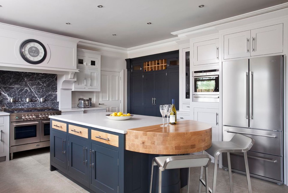 Eat-in kitchen - large transitional u-shaped ceramic tile eat-in kitchen idea in Belfast with an undermount sink, beaded inset cabinets, quartzite countertops, gray backsplash, stone slab backsplash, stainless steel appliances, an island and white cabinets