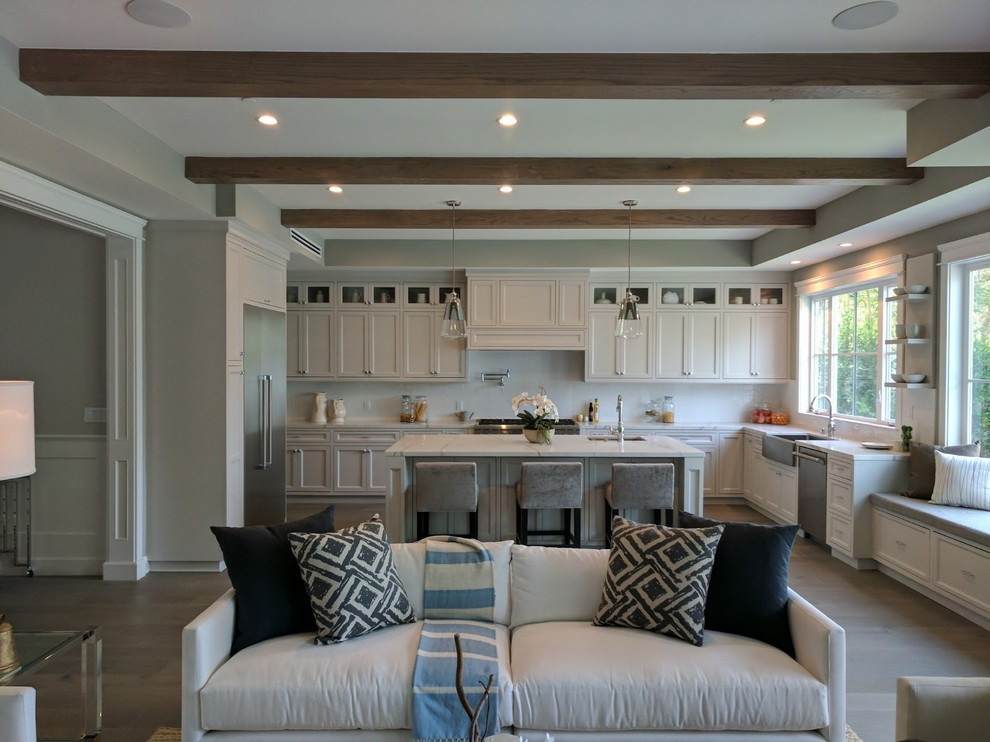 Inspiration for a large modern u-shaped porcelain tile, gray floor and exposed beam eat-in kitchen remodel in Orange County with an undermount sink, recessed-panel cabinets, white cabinets, quartz countertops, white backsplash, stone slab backsplash, stainless steel appliances, an island and white countertops