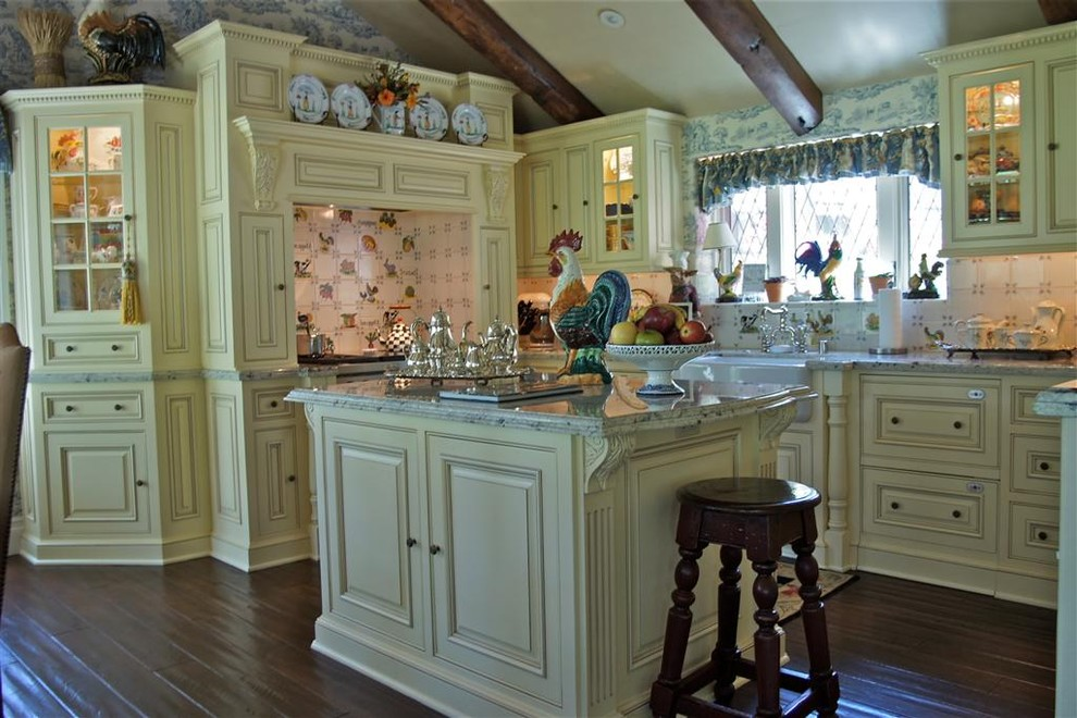 Kitchen - french country u-shaped kitchen idea in Los Angeles with a farmhouse sink, beaded inset cabinets, yellow cabinets and white backsplash