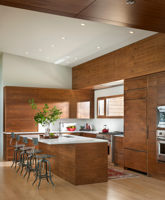 Kitchen - contemporary l-shaped light wood floor kitchen idea in Other with an undermount sink, flat-panel cabinets, medium tone wood cabinets, paneled appliances and an island