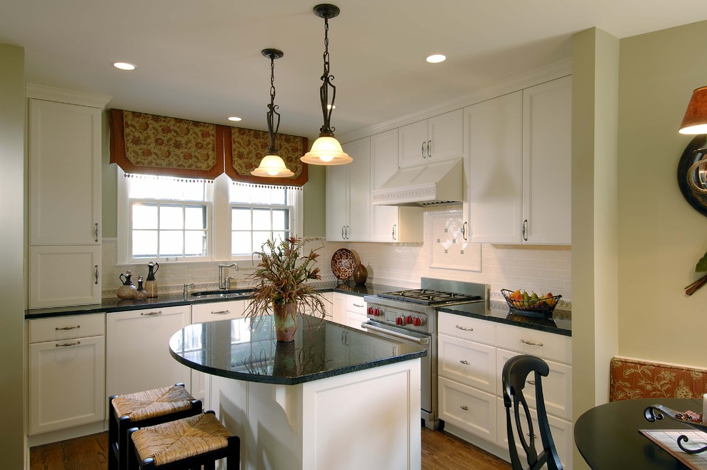 Example of a classic kitchen design in Minneapolis with recessed-panel cabinets, subway tile backsplash, white cabinets and white backsplash