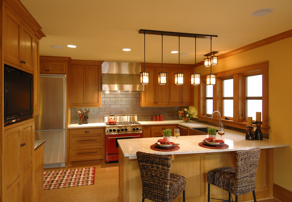 Example of a classic kitchen design in Minneapolis with stainless steel appliances and subway tile backsplash