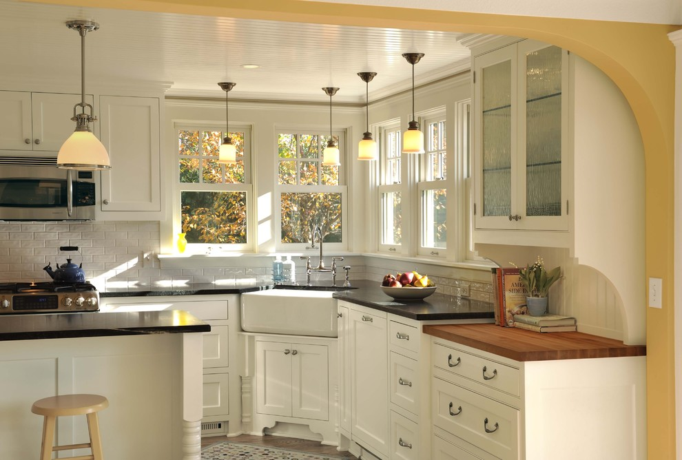 Example of a classic kitchen design in Minneapolis with subway tile backsplash, a farmhouse sink, beaded inset cabinets, white cabinets and white backsplash