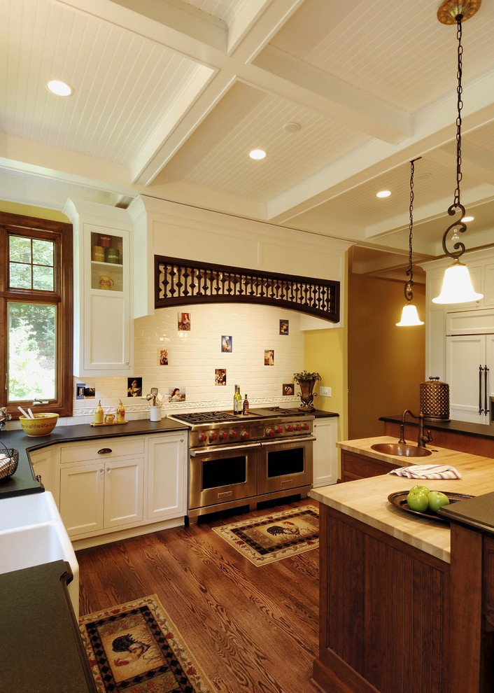Kitchen - traditional kitchen idea in Minneapolis with a farmhouse sink and stainless steel appliances