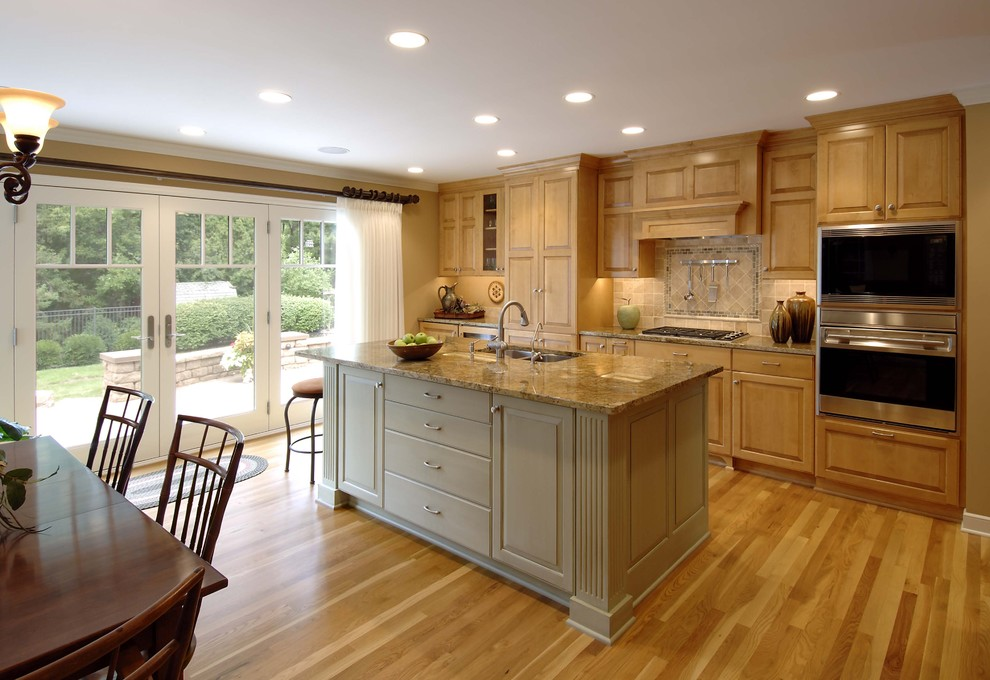Kitchen - traditional kitchen idea in Minneapolis with raised-panel cabinets and stainless steel appliances