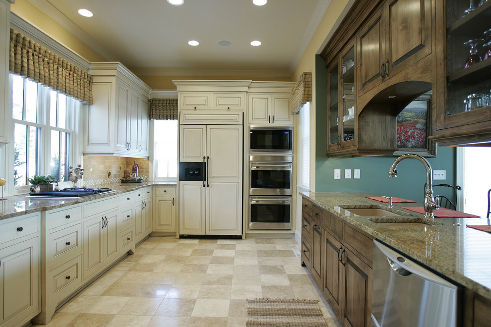 Kitchen - traditional kitchen idea in Minneapolis with glass-front cabinets and paneled appliances