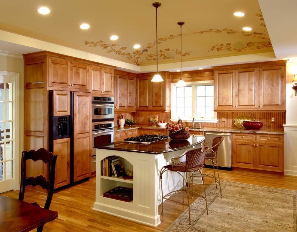 Elegant kitchen photo in Minneapolis with paneled appliances